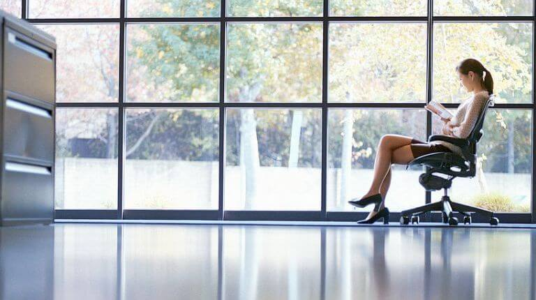 Lady sitting in a large office space