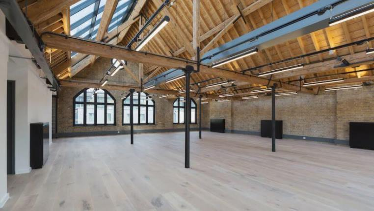 warehouse office space with exposed roof beams and rafters